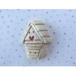beige shingle birdhouse